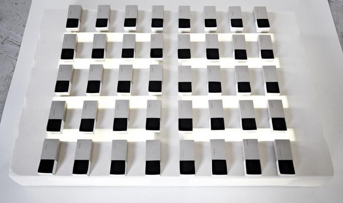 Joo-Hee Yang, Le Fond du Tiroir, 2015, 400 burnt matches box, neon, palette, fabric, 120 x 80 x 15cm